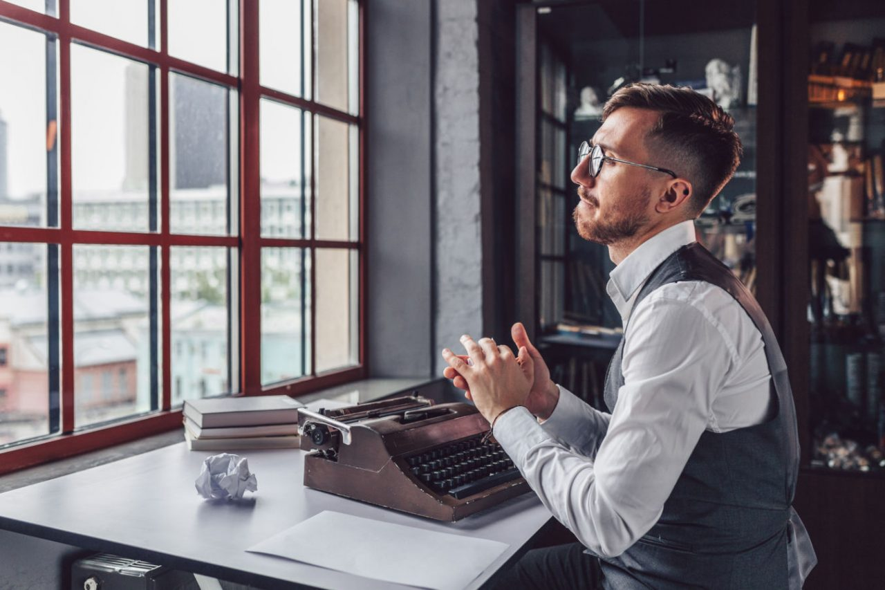 Writer with a retro typewriter